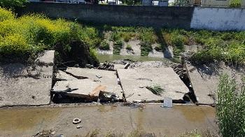 ترمیم و بازسازی دیواره بتنی تخریب شده کانال آبرسانی شهرستان رشت در منطقه هلال احمر توسط شرکت بهره برداری از شبکه های آبیاری گیلان